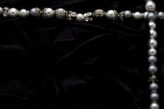 Costume Juwelery. Silver designer costume juwelery on black velvet background Royalty Free Stock Photo