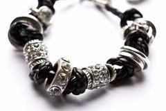 Costume Juwelery. Silver designer costume juwelery in macro on white background Stock Photography