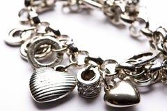 Costume Juwelery. Silver designer costume jewelery in macro on white background Stock Photos