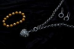 Costume Juwelery. Silver designer costume jewelery on black velvet background Stock Images