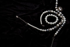 Costume Juwelery. Silver designer costume jewelery on black velvet background Royalty Free Stock Photos