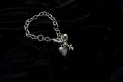 Costume Juwelery. Silver designer costume jewelery on black velvet background Stock Photo
