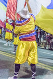 Costume Men with Flag Marching at Carnival Parade of Uruguay Royalty Free Stock Photo