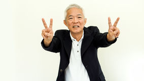 Costume occasionnel asiatique d'homme supérieur avec le visage et la main heureux g Image libre de droits