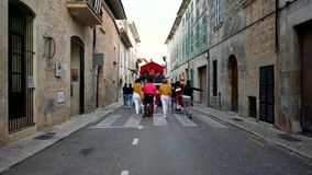 Barcelona, Spain 10.06.2019: Costume parade in Barcelona, Spain. Art. Rear view of many people in bright unusual clothes stock video footage