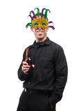 Costume Party. A man holding a beer bottle and wearing a feather mask, isolated against a white background Royalty Free Stock Image