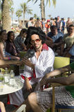 Costume party in the style of Elvis Presley on the Barceloneta beach Stock Images