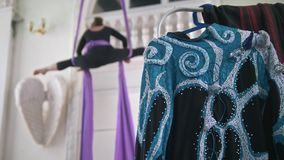 Costume for performances in front of air gymnast exercising on the aerial silk in a studio. Close up stock footage