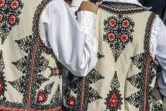 Costume piega rumeno tradizionale. Dettaglio 32 Immagini Stock