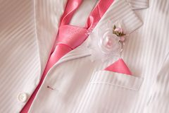 Costume with pink necktie and buttonhole Royalty Free Stock Photos