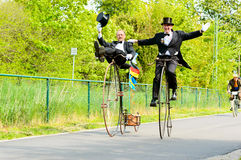 Costume ride. Solvesborg, Sweden - May 16, 2015: International Veteran Cycle Association (IVCA) 35th rally. Costume ride through public streets in town. Persons Royalty Free Stock Photo