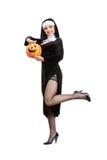 Costume series: sexy maid holding halloween pumpkin Stock Photography