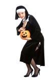 Costume series: sexy maid holding halloween pumpkin Royalty Free Stock Image