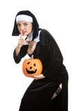 Costume series: sexy maid holding halloween pumpkin Royalty Free Stock Photos