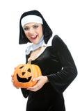 Costume series: sexy maid holding halloween pumpkin Royalty Free Stock Photo