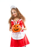 Costume series: sexy maid holding halloween pumpkin Royalty Free Stock Photo