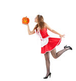 Costume series: sexy maid holding halloween pumpkin Royalty Free Stock Images