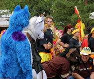 Costumed animals amongst crowd Royalty Free Stock Image