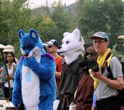 Costumed animals amongst crowd Stock Photo