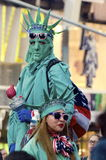 Costumed Beggars in Times Square. Two versions of the Statue of Liberty are among many costumed beggars in Times Square in New York City including cartoon Stock Photo