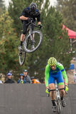 Costumed Bicycle Racer - big air on road bike Royalty Free Stock Photography