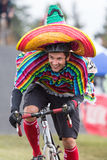 Costumed Bicycle Racer - Mexican. A Costumed male racer competes at a Halloween-themed cyclocross bicycle race on Oct 28, 2012 in Bend, Oregon Royalty Free Stock Photos