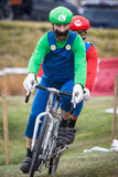 Costumed Bicycle Racers - Mario and Luigi Royalty Free Stock Photo