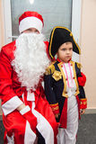 Costumed Boy posing with Santa Stock Images