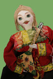 Costumed Doll Plays Mandolin Royalty Free Stock Photography