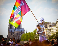 Costumed gay man wearing flag. Young man wearing a gay flag during the parade of the annual Gay Pride aka Marche des Fiertes LGBT on June 26, 2010 in Paris. Tens Stock Images
