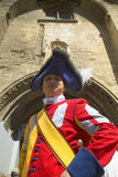 Costumed guard greeting people in front of Palace of the Popes, Avignon, France Royalty Free Stock Photography