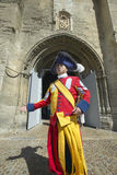 Costumed guard greeting people in front of Palace of the Popes, Avignon, France Stock Photo