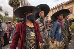 Costumed indigenous men at Indi Raymi. July 24, 2017 Cotacachi, Ecuador: costumed indigenous men at Inti Raymi wearing oversized hats Stock Photography