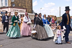 Costumed members of the Dickens Festival parade. BROADSTAIRS, UK-JUNE15: Members of the Dickens Festival Parade. This annual event celebrates Charles Dickens Stock Photography