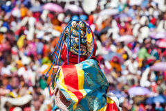 Costumed monk performs traditional dance at buddhist festival Stock Images