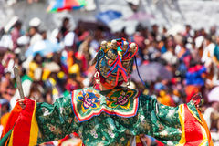 Costumed monk performs traditional dance at buddhist festival Stock Photos