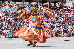 Costumed monk performs traditional dance at buddhist festival Royalty Free Stock Photography