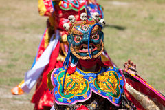 Costumed monk performs traditional dance at Dragon Festival Royalty Free Stock Images