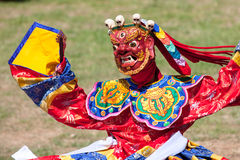 Costumed monk performs traditional dance at Dragon Festival Stock Photography