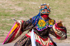 Costumed monk performs traditional dance at Dragon Festival Stock Images