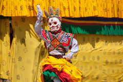 Costumed monk performs traditional dance at Dragon Festival Royalty Free Stock Photo