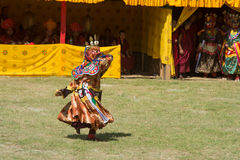 Costumed monk performs traditional dance in Tsechu festival at wangdi phodrang bhutan Stock Images