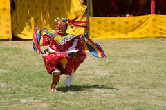 Costumed monk performs traditional dance in Tsechu festival at wangdi phodrang bhutan. WANGDI PHODRANG ,BHUTAN - SEPTEMBER 24 2012 : Costumed monk performs Royalty Free Stock Images