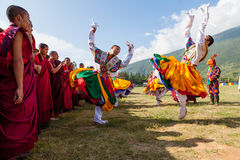 Costumed monks perform traditional dance at Dragon Festival Royalty Free Stock Photo