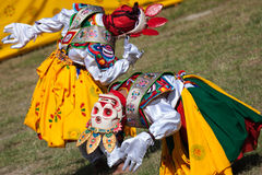 Costumed monks perform traditional dance at Dragon Festival Stock Photography