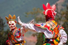 Costumed monks perform traditional dance at Dragon Festival Royalty Free Stock Photos