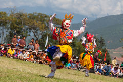 Costumed monks perform traditional dance at Dragon Festival Stock Images