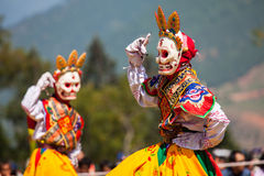 Costumed monks perform traditional dance at Dragon Festival Royalty Free Stock Images