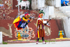 Costumed monks perform traditional dance at Dragon Stock Image