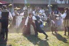 Costumed participants dancing at Renaissance Festival Royalty Free Stock Image